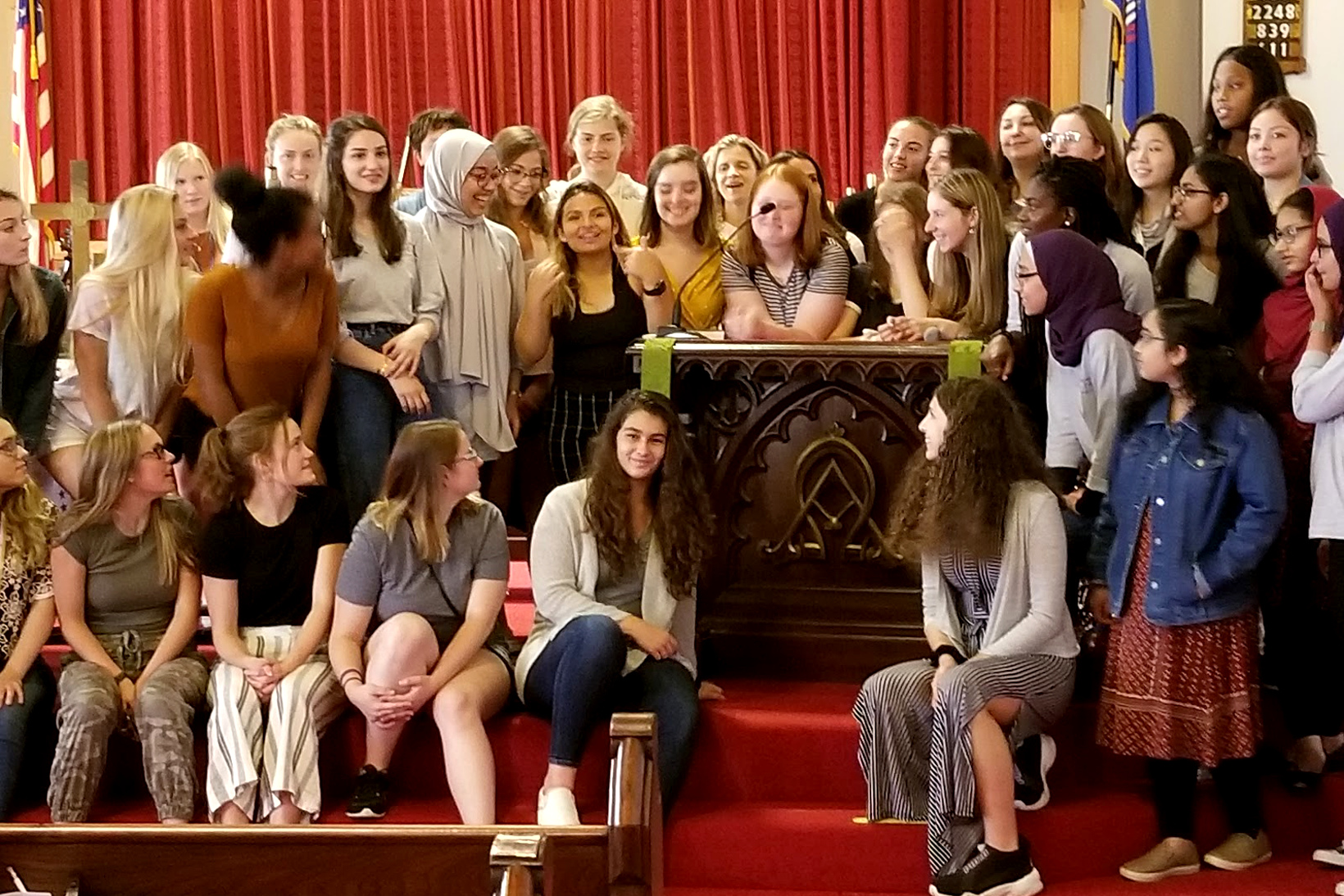 Groups of students pose near a pulpit that Alice Paul spoke from