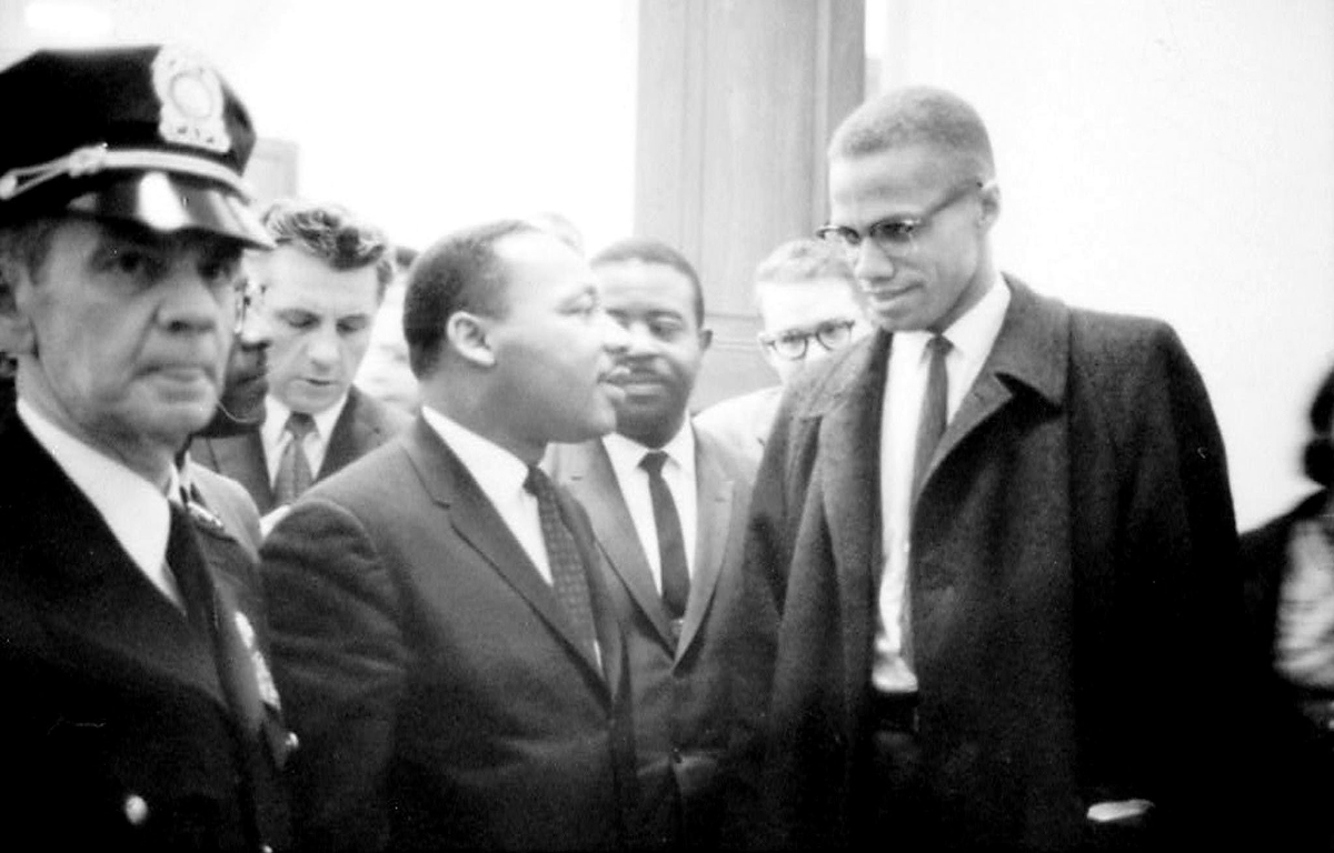Martin Luther King Jr and Malcolm X shake hands